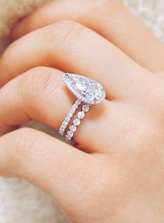 Eternal love. This stunning platinum pear shaped engagement ring and eternity custom wedding ring will give you a lifetime of shine, handcrafted by Ascot Diamonds #beautifulweddingringsjewelry #fineweddingring