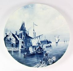 "Delft charger, porcelain, having blue and white scene of canal boats, 17 1/2"" diameter. Provenance: from the personal collection of Larry and Joy Redman of Lompoc, California."