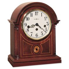 The Clearbrook Mahogany Mechanical Hermle Mantel Clock is designed in an elegant barrister style along with a rich mahogany finish. This piece is finished with fluted columns, exquisite inlaid marquetry, ivory dial and Arabic numerals. Wooden Columns, Fluted Columns, Tabletop Clocks, Mantel Clocks, Wall Clocks, Westminster, Radios, Howard Miller, Antique Clocks