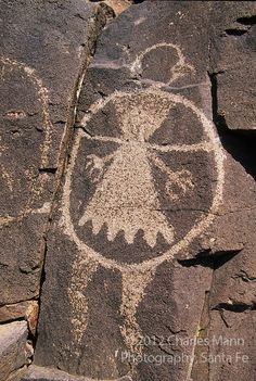Petroglyph resembling a bird and a man called a shield man on the volcanic outcropping near the village of Galesteo, New Mexico. Anasazi
