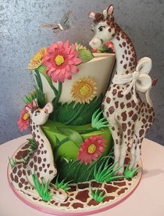 Giraffes and Flowers Whimsical Cake too cute great for any kids event.