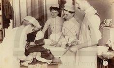 Nurses assisting at osteotomy for genu-valgum, Bellevue Hospital, New York, 1890s.