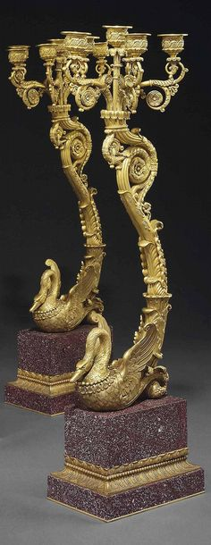 A PAIR OF FRENCH ORMOLU AND PORPHYRY SIX-LIGHT CANDELABRA <br />OF EMPIRE STYLE, LATE 19TH CENTURY <br />En suite with the previous lot, each modelled with a swan issuing an 'S'-scrolled acanthus-wrapped stem surmounted by a candelabrum, on a rectangular stepped porphyry-veneered plinth<br />28 in. (71 cm.) high (2)<br />