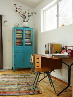 turquoise cabinet-- we took an old cabinet that was my great granny crawford's and painted it turquoise with a bright green interior.