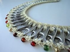 a necklace made from soda can tabs Soda Tab Crafts, Can Tab Crafts, Tape Crafts, Diy Crafts, Kumihimo Bracelet, Pop Top Crafts, Pop Can Tabs, Jewelry Crafts, Handmade Jewelry