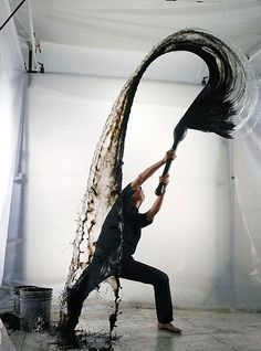 """Japanese artist Shinichi Maruyama working on his """"Kusho"""" series, which represents the interplay of black ink and water, both in midair and on white surfaces."""