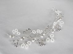 This versatile delicate branch is beautifuly crafted using silver wire, Swarovski crystals and freshwater pearls. This headpiece is very flexible and shapeable to suit almost any hair style. It can be used as a headband, a hair vine positioned in the back, on the side, on top or in
