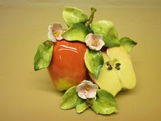 Eva Gordon Studio Design Ceramics - Tabletop - Red apple and a half with pink blossoms.
