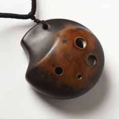 TaiChi Pendant Ocarina in Soprano G Strawfired by Focalink. $21.00. This ocarina in Soprano, key of G4-B5, has a bright sound, yet is deeper sounding than a Soprano C. The pendant shape and necklace make it easy to carry a tune with you wherever you go. A Songbook/Tutorial is included, making this instrument accessible to professionals and amateurs alike.   This ocarina was produced by Zack Shih of Focalink, based in Taiwan.  His instruments are of exceptional q...