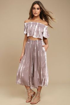 Escape to somewhere exotic with the Boho Me Ecuador Taupe Tie-Dye Two-Piece Jumpsuit! Breezy woven rayon features a tie-dye design as it shapes an OTS crop top with a smocked neckline and fluttering sleeves. Matching culottes have side seam pockets, a smocked waist, and wide flared legs.