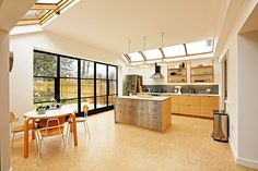 Light extension and refurbishment of this family home in Twickenham. An elegant plywood kitchen and cork floors give a crisp, timeless finish. Kitchen Dining, Dining Room, Plywood Kitchen, Strawberry Hill, Crittall, Cork Flooring, Elegant Kitchens, Round House, Large Homes