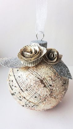 DIY ornament. Love this! Glass or plastic ornament (new or used) + music/hymn + mod podge + glitter = gorgeous!!!