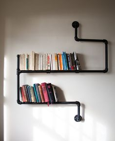 These mod metal pipe shelves. | 24 Times Bookshelf Porn Was Just So Fucking Hot
