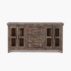 This credenza pairs an old weathered patina with the ease of contemporary storage. Constructed from Mango and Reclaimed Wood, the credenza sports three deep drawers flanked on either side by a pair of doors with glass insets. The metal pulls and exterior painted hinges add further detail with their rustic style. http://www.mealeysfurniture.com/inventory/product/4711091/_credenza