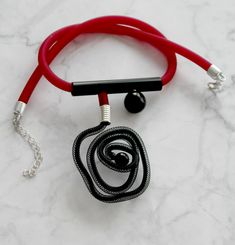 This necklace looks like it came out of space. Combining wine red and night black rubber and the black nylon mesh. The whole element is build of your j the plastic tube. Get ready for many questions about it from your friends. Black Costume, Costume Necklaces, Unusual Jewelry, Pink Jewelry, Contemporary Jewellery, Black Rubber, Chokers, Bling, Rubber Material