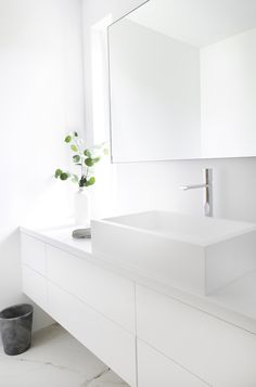 White on white bathroom is beyond classic it is a staple. Finding accessories that can be used to bring interest or plants can be just enough to complete your bathroom