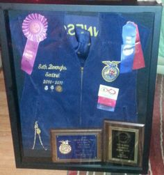 FFA blue and gold jacket along with awards ribbons and symbols of FFA career. Makes a great keepsake! We did thus for my daughter's boyfriend for Christmas.