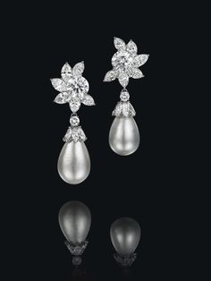 An Exceptional Pair of Natural Pearl and Diamond Ear Pendants, by Harry Winston (est. $2.8 to $3.4 million)