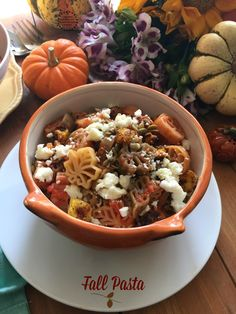 Easy fall pasta made with roasted garlic marinara sauce butternut squash chipotle pepitas and queso fresco
