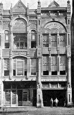 """This building has large stone at top engraved """"Times Herald Building"""" The year 1889 is also visible at the right top. Police Station appears over the third floor windows and it appears that the large door on bottom right would be for a horse drawn fire equipment. The Adolphus Hotel now occupies this location. The building was located next to city hall on Commerce Street and 319 also appears on one of the windows...Dallas, Texas, Photo from Portal to Texas History."""