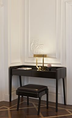 small writing desk in a hallway ~ perfect for guests to use their laptops, charge their phones, or use as it was intended ~ to write upon                                                                                                                                                      More