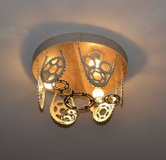 Designer bike lamp lighting fixture chandelier cycle Bicycle Parts Art, Bicycle Art, Bike Design, Lamp Design, Vintage Lighting, Industrial Lighting, Bike Craft, Recycled Lamp, Steampunk Lamp