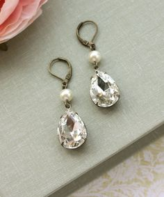 A Vintage Clear Glass Pear Jewels, Ivory Swarovski Pearl Short Dangle Earrings. Vintage Style. Bridesmaid Earrings. Maid of Honor. For Her.. $24.50, via Etsy.