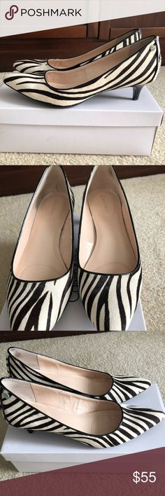 Calvin Klein Nicki Zebra Pony Print Kitten Heels Style #E4033 Color - black and white Size 9.5M I purchased these shoes a few years ago and have never been able to wear them.  My feet are to wide to wear them comfortably.  Finally time to sell them.  These shoes come from a smoke free home. Calvin Klein Shoes Heels