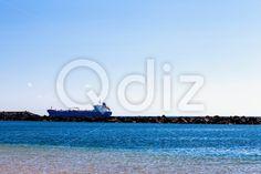 Qdiz Stock Photos | Cargo ship on the water,  #bay #blue #breakwater #cargo #harbor #nautical #ocean #port #sea #ship #sky #summer #transport #vessel #water #wave