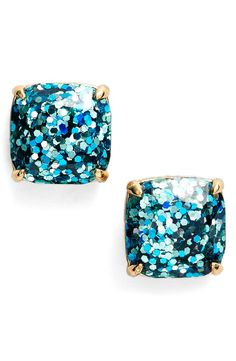 Polishing off the party look with these sparkling Kate Spade turquoise glitter earrings.