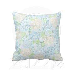 Hydrangea Love  This beautiful 20 x 20 100% throw pillow will add a touch of beauty to any room with the pale blue background covered in hydrangea blossoms in varying shades of blue and white accented with light green foliage along with light white butterflies fluttering abo