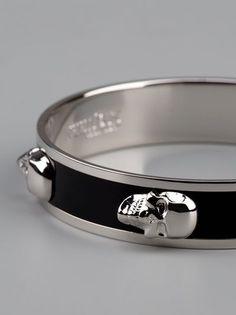 Alexander McQueen silver 'skull' bracelet with contrasting black enamel. #alexandermcqueenskull