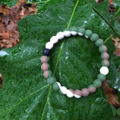 - The White Bead - Stay Humble - Carrying water from Mount Everest, the highest point on Earth, the white bead represents life's highest moments. It's those times when you're feeling on top of the wor
