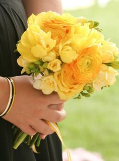 Maybe for bridesmaids? Yellow ranunculus. With turquoise/aqua floral tape/ribbon