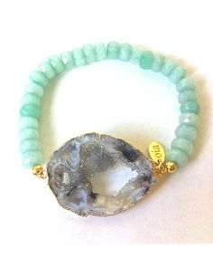 Mint amazonite beads paired with a natural colored  agate that has been plated in a 14K gold Bracelet.  Each agate is one of a kind and colors range from black/grey to beige. I like one-of-a-kind jewelry.