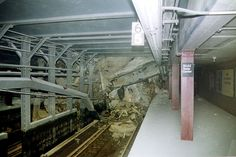~ Rubble covers the tracks of the NYC Subway + lines in the Cortland Street station under the World Trade Center, in this photo taken shortly after the attacks. World Trade Center, Trade Centre, 911 Never Forget, Lest We Forget, Bodies, S Bahn, Nyc Subway, Powerful Images, Modern History