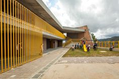Completed in 2015 in Vereda Chaparral, Colombia. Images by Alejandro Arango , Julián Castro. This project consists of replacing a school in bad conditions for a new building, using the same plot of land on Chaparral lane in the Municipality. School Architecture, Modern Architecture, Primary School, Elementary Schools, Julian Castro, St Clare's, School Plan, Catholic School, Police Station