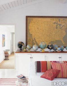 I am really drawn to old maps and globes - there is something incredibly rich and appealing about the cluster of various globes in this room. Room design featured on Lauren Casey Interiors from Elle Decor magazine.