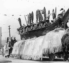 Canoe on float in parade, drawn by horses, Seattle, Washington, ca. 1911 :: American Indians of the Pacific Northwest -- Image Portion