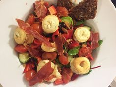 Salad with goat cheese, parma and baked tomatoes. Get the full recipes at: http://josephine.helbrandt.dk