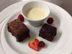 Double chocolate brownie, chilled creme anglaise, fresh berries and chocolate pistachio fudge. So naughty but so nice!!