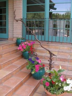 the trim color, the pots and the rustic railing.