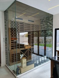 We manufactured the solid oak wine displays for this stunning wine cellar. We also manufactured the bar chair in the second photo.  Kühn Houtwerke is situated in the Boland, Cape Winelands area. We specialize in kitchen cupboards, bedroom cupboards, solid woodworking, custom furniture and much more. For a quotation please send an email to khoutwerke@icon.co.za and we will be happy to assist. Follow us on Pinterest for our latest pins. Bedroom Cupboards, Kitchen Cupboards, Wine Display, Wine Cellars, Bar Counter, Bar Chairs, Custom Furniture, Solid Oak, Quotation