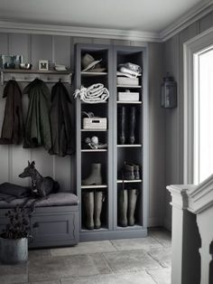 Stylish built-in storage for boots, hats and baskets keeps this busy area well organised. The charcoal grey finish complements the striped pewter wallpaper for a smart look. Get the look: Pembroke fitted storage, from £775, Neptune