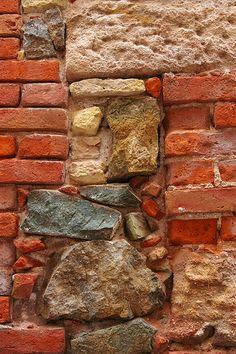 "Rubble masonry - ""Example of use of ballast brick, limestone and rubble stone (blue bit) to make walls of buildings"""