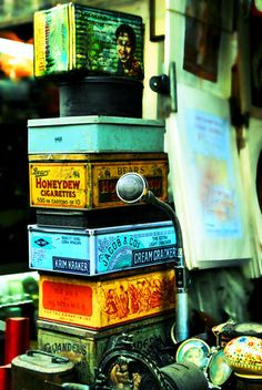 old rusty tins! i think i have the middle one of these - crackers.