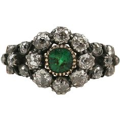 My God- normally diamonds don't impress me much, but anthing Georgian makes my heart beat a little faster:  Diamond and Emerald Georgian Flower Ring - Primavera Gallery NY found on Polyvore
