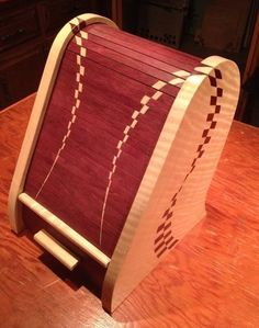 Spectacular. From lumberjocks.com [Apparently rather tedious inlay work; nice results]