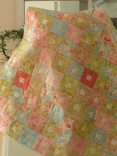"""tutorial. 11/2 ' square center sashed by 1 1/2 """" strips. Used honey buns but can use yardage as well."""