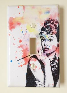 Audrey Hepburn from Breakfast at Tiffanies Decorative Light Switch Plate Cover. $9.00, via Etsy.
